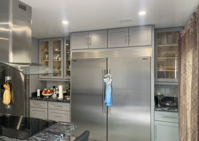 Image highlighting kitchen refrigerator in new remodel